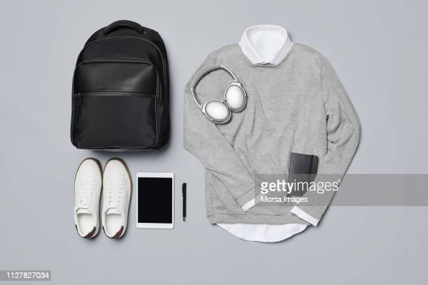 "men""u2019s clothing with technologies and personal accessories - flat lay stock pictures, royalty-free photos & images"