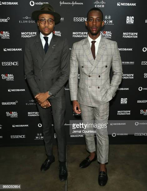 Menzi Mcunu and Monde Goozin attend the Global Citizen Festival Mandela 100 Launch Event at the Circa Gallery on July 9 2018 in Johannesburg South...