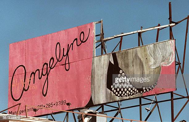 RMc Angelyne billboard at the intersection of Las Palmas Avenue and Hollywood Blvd Los Angeles The head portion of the billboard has fallen down...