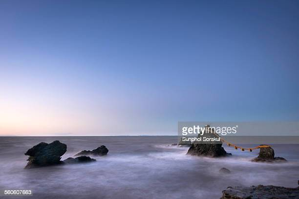 meoto iwa (wedding rocks) at sunset - ise mie stock pictures, royalty-free photos & images