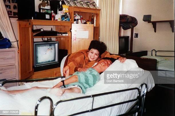 MEParentsKawaguchi8/28/97 In this copy of a 1995 snapshot Raymond Kawaguchi is visited by his sister Teresa Kawaguchi Anamunthodo at the Fairview...