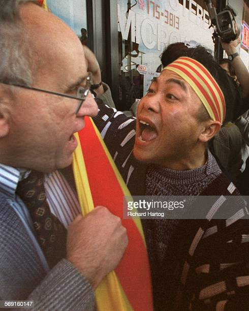MEProtestConfrontationRH––0211998––Separated by only a South Vietnamese flag protester Giang Ho right has fighting words for David J Brown in front...