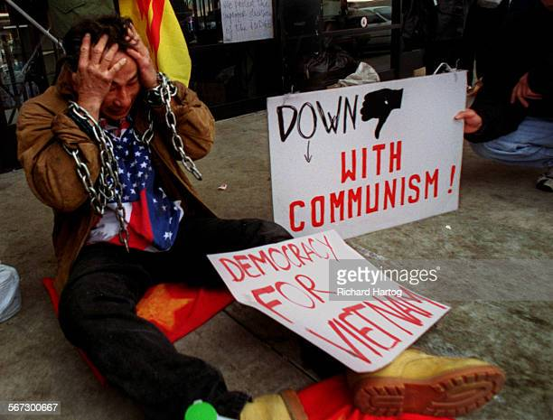 MEProtestHungRH––021199––Tears fall from the eyes of anti–Communist protester Hung Nguyen as he takes part in demonstrations in front of Truong Van...