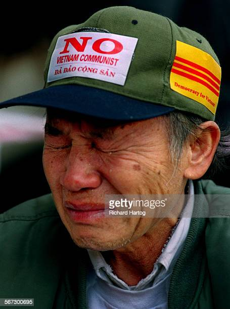 MEProtestNguyenRH––021199––Tears fall from the eyes of anti–Communist protester Andy Nguyen as he takes part in demonstrations in front of Truong Van...
