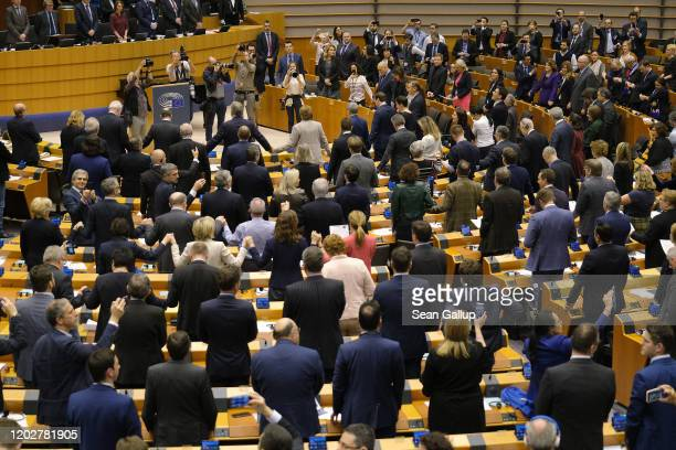 MEPs of the European Parliament, some holding hands, rise to sing 'Auld Lang Syne' following a historic vote on the Brexit agreement at a session of...