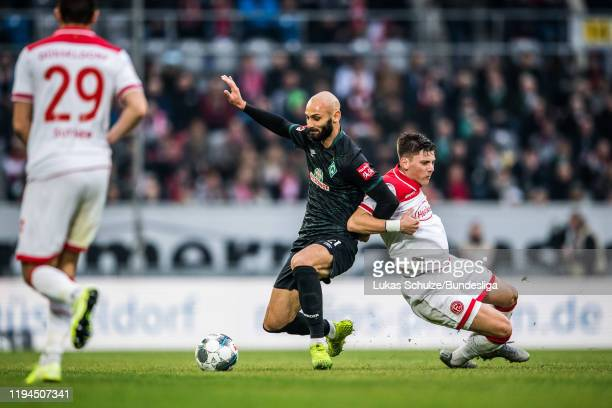 Ömer Toprak of Bremen in action against Dawid Kownacki of Düsseldorf during the Bundesliga match between Fortuna Düsseldorf and SV Werder Bremen at...