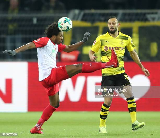 …mer Toprak of Dortmund is challenged by Caiuby of Augsburg during the Bundesliga match between Borussia Dortmund and FC Augsburg at Signal Iduna...