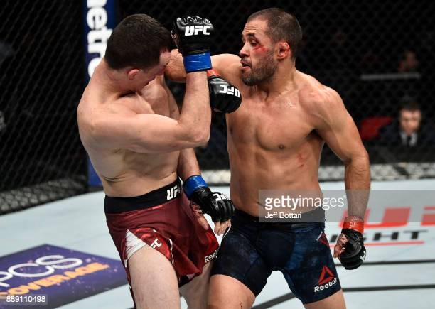 Merab Dvalishvili elbows Frankie Saenz in their bantamweight bout during the UFC Fight Night event inside Save Mart Center on December 9 2017 in...