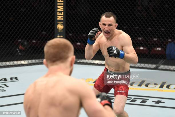 Merab Dvalishvili of Georgia battles Casey Kenney in their bantamweight bout during the UFC Fight Night event at Santa Ana Star Center on February...