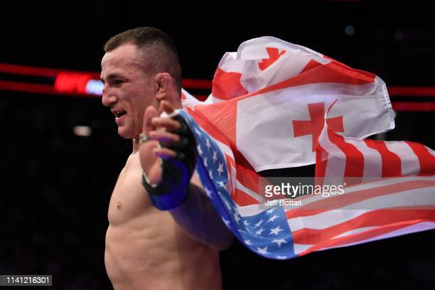 Merab Dvalishvili of Georgia celebrates his victory over Brad Katona of Canada in their bantamweight bout during the UFC Fight Night event at...