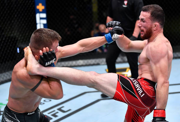Merab Dvalishvili of Georgia kicks Cody Stamann in a bantamweight bout during the UFC Fight Night event at UFC APEX on May 01, 2021 in Las Vegas,...