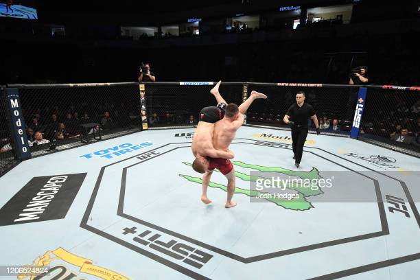 Merab Dvalishvili of Georgia picks up Casey Kenney in their bantamweight bout during the UFC Fight Night event at Santa Ana Star Center on February...