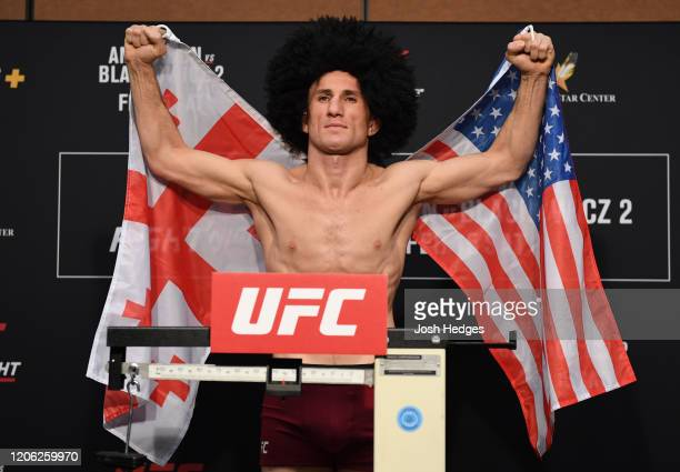 Merab Dvalishvili of Georgia poses on the scale during the official UFC weighin at the Albuquerque Marriott Pyramid North on February 14 2020 in...