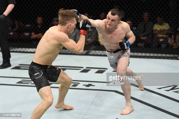 Merab Dvalishvili of Georgia punches Brad Katona of Canada in their bantamweight bout during the UFC Fight Night event at Canadian Tire Centre on May...
