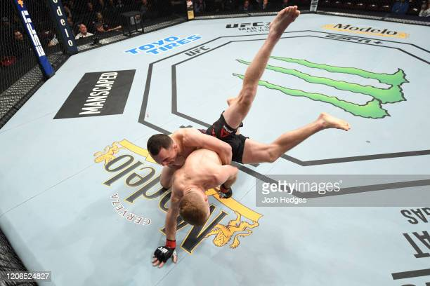 Merab Dvalishvili of Georgia takes down Casey Kenney in their bantamweight bout during the UFC Fight Night event at Santa Ana Star Center on February...