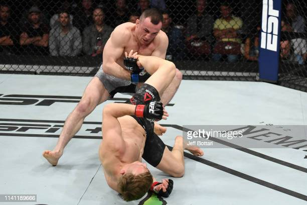 Merab Dvalishvili of Georgia tales down Brad Katona of Canada in their bantamweight bout during the UFC Fight Night event at Canadian Tire Centre on...