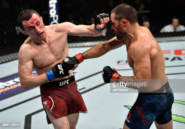 Merab Dvalishvili punches Frankie Saenz in their bantamweight bout during the UFC Fight Night event inside Save Mart Center on December 9 2017 in...