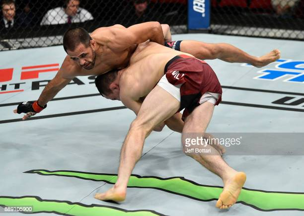 Merab Dvalishvili takes down Frankie Saenz in their bantamweight bout during the UFC Fight Night event inside Save Mart Center on December 9 2017 in...