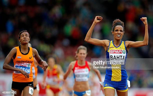 Meraf Bahta of Sweden celebrates as she crosses the finish next to Sifan Hassan of the Netherlands to win gold in the Women's 5000 metres final...