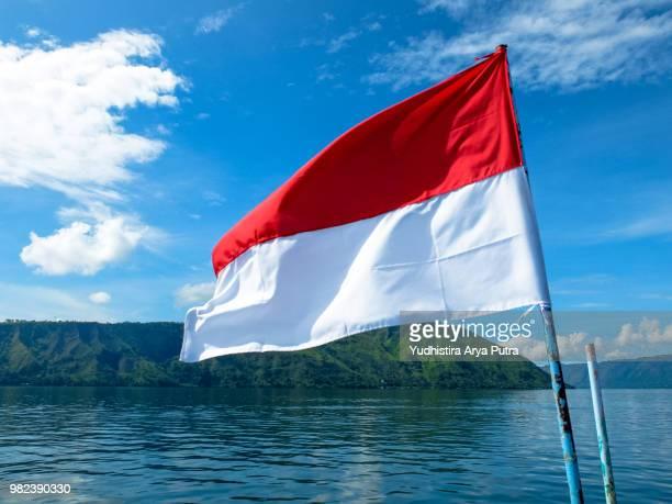 merah putih danau toba - indonesia flag stock photos and pictures