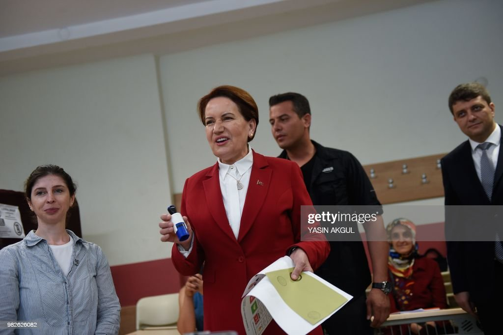 Meral Aksener, Iyi (Good) Party leader and presidential candidate, holds her ballot as she readies to vote at a polling station in snap twin Turkish presidential and parliamentary elections in Istanbul on June 24, 2018. - Turks began voting in dual parliamentary and presidential polls seen as the President's toughest election test, with the opposition revitalised and his popularity at risk from growing economic troubles.
