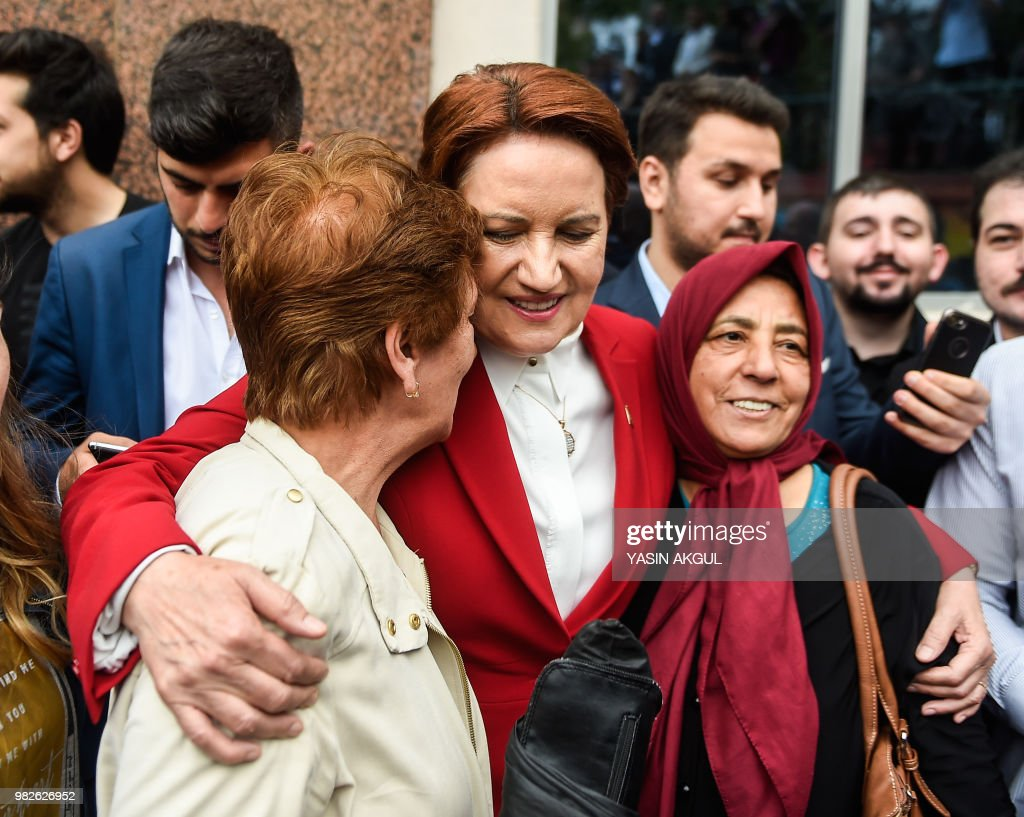 Meral Aksener, Iyi (Good) Party leader and presidential candidate, poses for a photograph after casting her ballot at a polling station in snap twin Turkish presidential and parliamentary elections in Istanbul on June 24, 2018. - Turks began voting in dual parliamentary and presidential polls seen as the President's toughest election test, with the opposition revitalised and his popularity at risk from growing economic troubles.