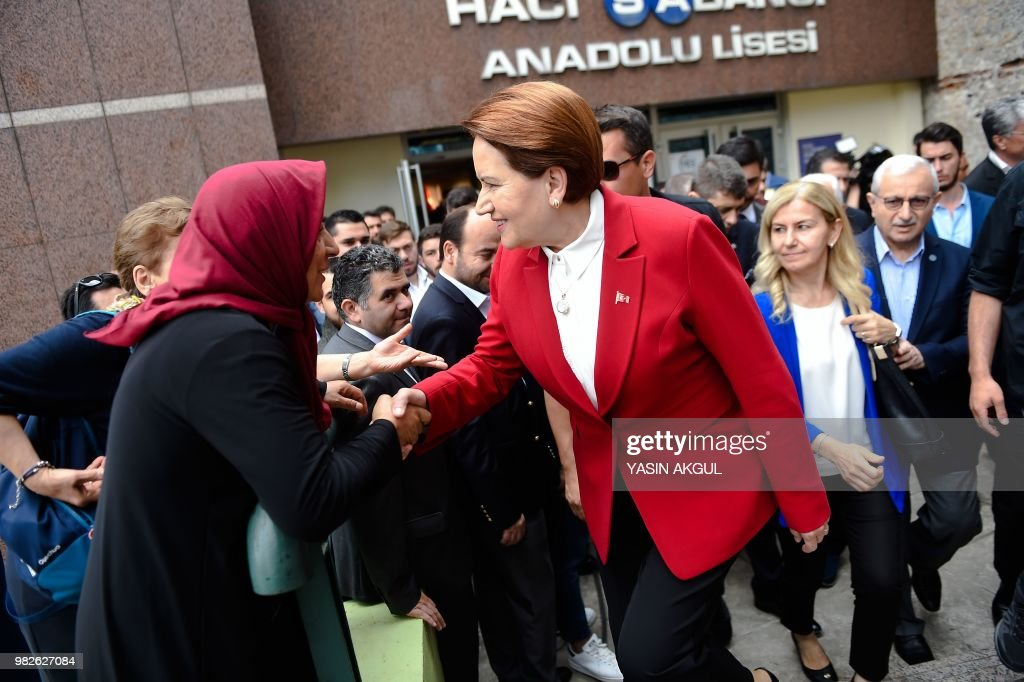 Meral Aksener, Iyi (Good) Party leader and presidential candidate, shakes hands after casting her ballot at a polling station in snap twin Turkish presidential and parliamentary elections in Istanbul on June 24, 2018. - Turks began voting in dual parliamentary and presidential polls seen as the President's toughest election test, with the opposition revitalised and his popularity at risk from growing economic troubles.