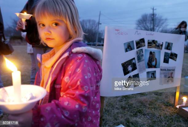 Mercede Lynne Bryant cousin of Jessica Marie Lunsford takes part in a candlelight vigil March 5 2005 in Roachester Ohio Lunsford's mom and much of...