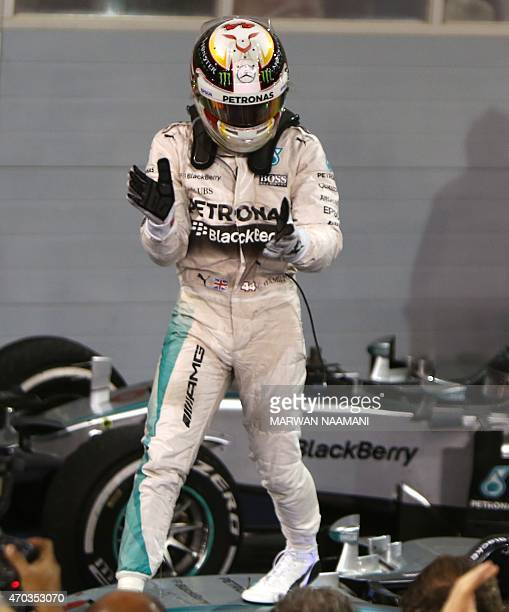 Mercedes AMG Petronas British driver Lewis Hamilton celebrates on top of his car after winning the Formula One Bahrain Grand Prix at the Sakhir...
