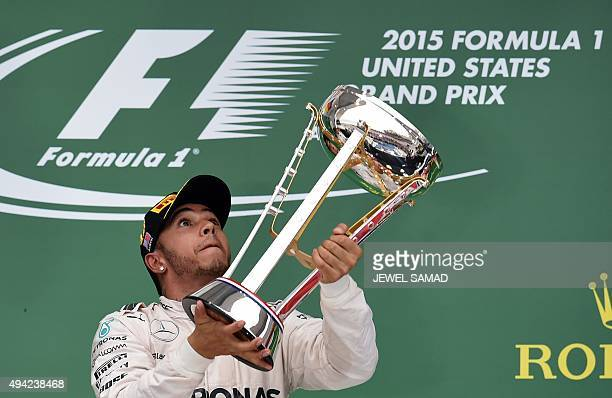 Mercedes AMG Petronas British driver Lewis Hamilton celebrates with his trophy on the podium after winning the US Formula One Grand Prix at the...