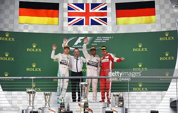 Mercedes AMG Petronas British driver Lewis Hamilton with Paddy Lowe Mercedes Technical Executive Director teammate German driver Nico Rosberg and...