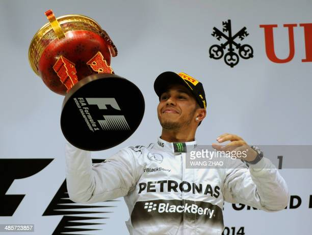 Mercedes AMG Petronas driver Lewis Hamilton of Britain lifts his trophy after winning the Formula One Chinese Grand Prix in Shanghai on April 20 2014...