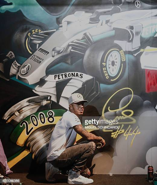 Mercedes AMG Petronas F1 Team British driver Lewis Hamilton poses after signing a graffiti in Sao Paulo on November 09 2016 Brazil F1 Grand Prix will...