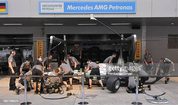 Mercedes AMG Petronas F1 team pitcrew members practice for tyre change exercise during the track familiarization and system checks for the Indian...