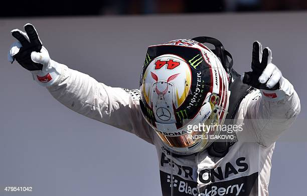 Mercedes AMG Petronas F1 Team's British driver Lewis Hamilton celebrates after winning the British Formula One Grand Prix at the Silverstone circuit...