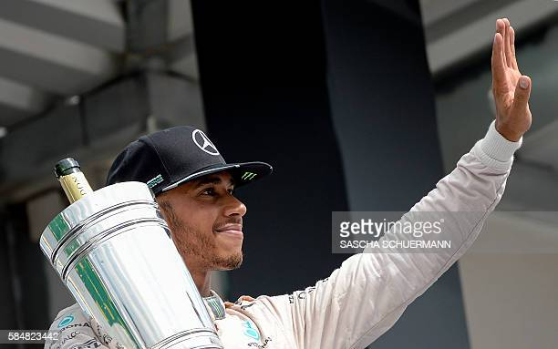 Mercedes AMG Petronas F1 Team's British driver Lewis Hamilton celebrates after winning at the Hockenheim circuit southern Germany on July 31 2016...