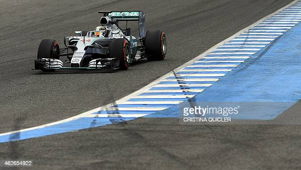 Mercedes AMG Petronas F1 Team's British driver Lewis Hamilton drives on the second day of the Formula One preseason tests at Jerez racetrack in Jerez...