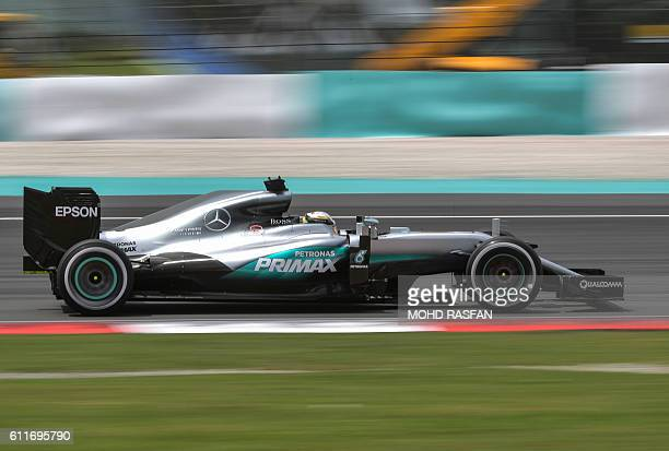 TOPSHOT Mercedes AMG Petronas F1 Team's British driver Lewis Hamilton drives during the third practice session of the Formula One Malaysian Grand...
