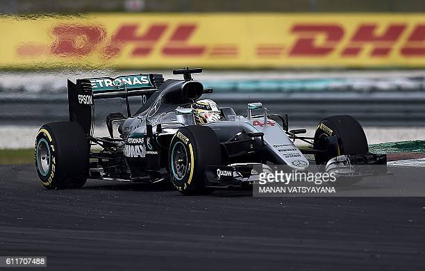 Mercedes AMG Petronas F1 Team's British driver Lewis Hamilton drives during the qualifying session of the Formula One Malaysian Grand Prix in Sepang...