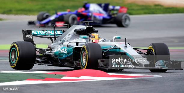 Mercedes AMG Petronas F1 Team's British driver Lewis Hamilton drives ahead of Scuderia Toro Rosso's Russian driver Daniil Kvyat at the Circuit de...