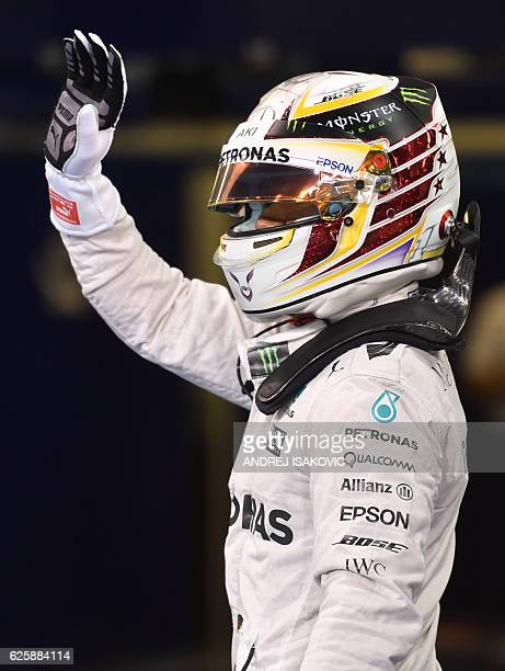Mercedes AMG Petronas F1 Team's British driver Lewis Hamilton gestures after taking pole position in the qualifying session as part of the Abu Dhabi...