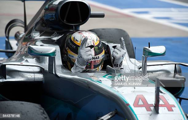 Mercedes AMG Petronas F1 Team's British driver Lewis Hamilton celebrates in finish area after the Formula One Grand Prix of Austria at the Red Bull...