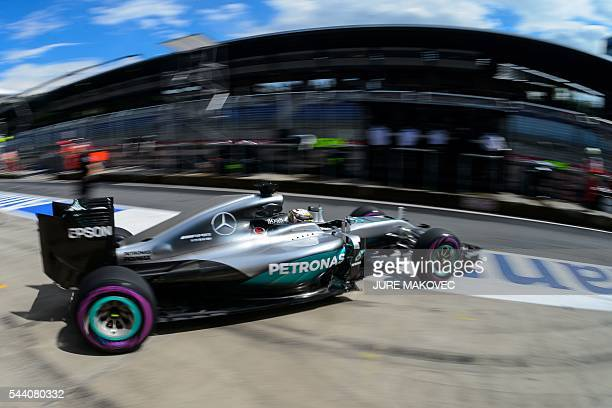 TOPSHOT Mercedes AMG Petronas F1 Team's British driver Lewis Hamilton leaves the pit lane during the second practice session of the Formula One Grand...