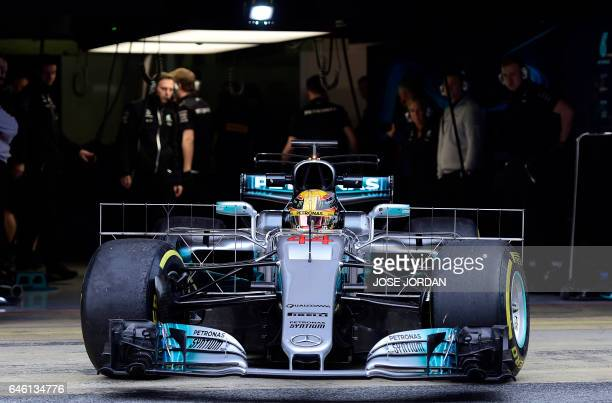 Mercedes AMG Petronas F1 Team's British driver Lewis Hamilton leaves the garage at the Circuit de Catalunya on February 28 2017 in Montmelo on the...