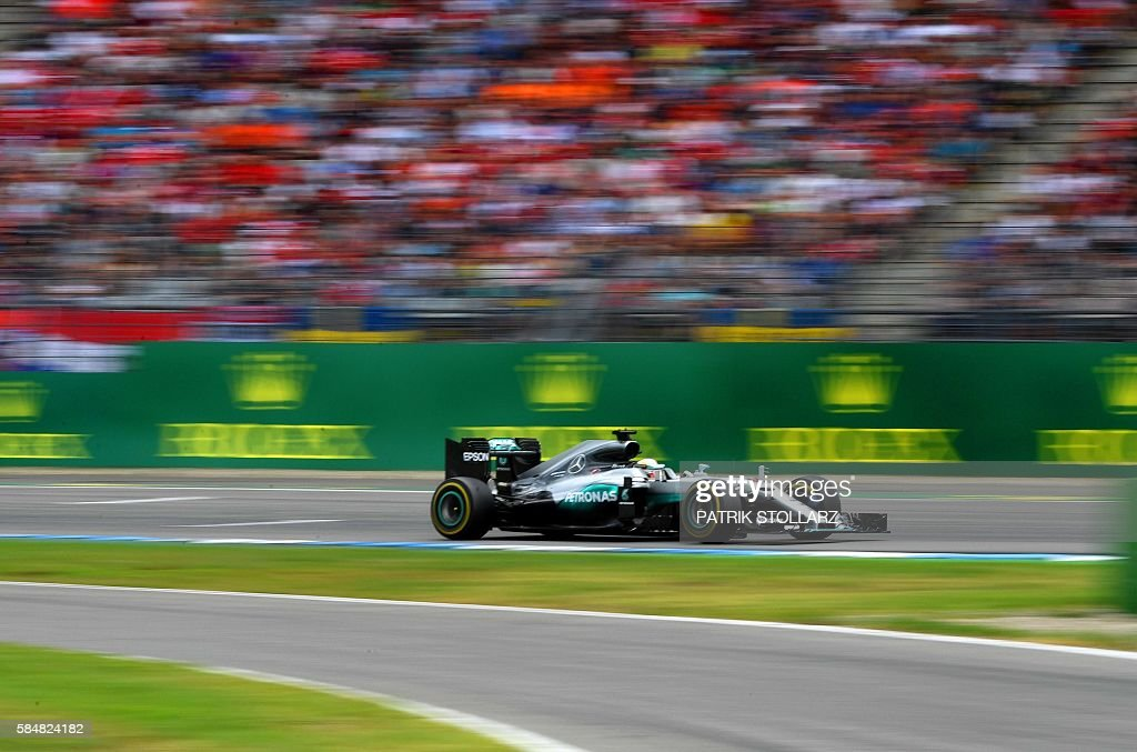 TOPSHOT - Mercedes AMG Petronas F1 Team's British driver Lewis Hamilton races at the Hockenheim circuit, southern Germany, on July 31, 2016 during the Formula One Grand Prix of Germany. /
