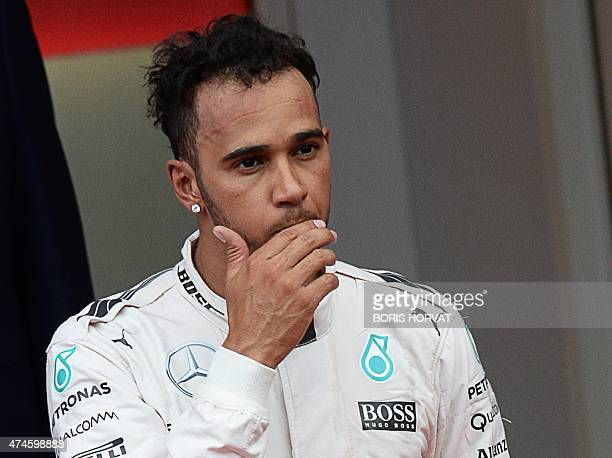 Mercedes AMG Petronas F1 Team's British driver Lewis Hamilton reacts after taking third place on the podium after the Monaco Formula One Grand Prix...