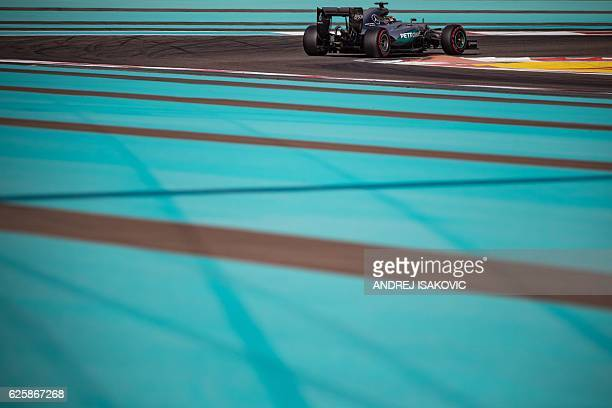 Mercedes AMG Petronas F1 Team's British driver Lewis Hamilton steers his car during the third practice session as part of the Abu Dhabi Formula One...