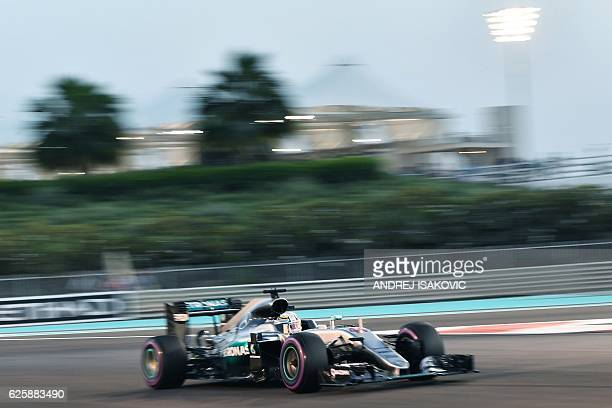 Mercedes AMG Petronas F1 Team's British driver Lewis Hamilton steers his car during the qualifying session as part of the Abu Dhabi Formula One Grand...