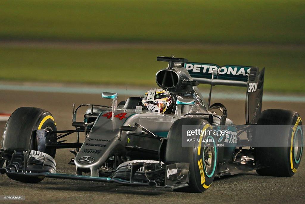 Mercedes AMG Petronas F1 Team's British driver Lewis Hamilton steers his car during the Abu Dhabi Formula One Grand Prix at the Yas Marina circuit on November 27, 2016. / AFP / Karim Sahib