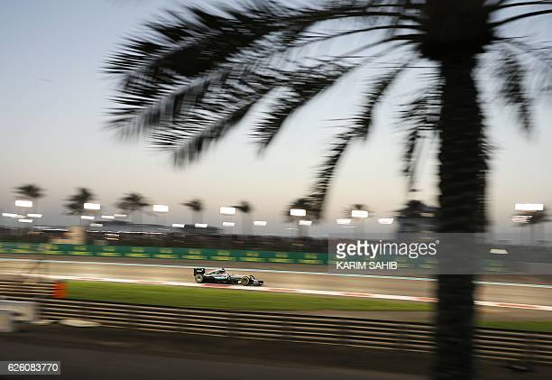 TOPSHOT Mercedes AMG Petronas F1 Team's British driver Lewis Hamilton steers his car during the Abu Dhabi Formula One Grand Prix at the Yas Marina...
